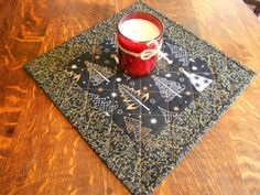 Quilted Candle Mat/ Small Table Topper in Black and Gold Christmas Fabric by…