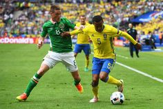 Martin Olsson of Sweden and James McCarthy of Republic of Ireland compete for the ball during the UEFA EURO 2016 Group E match between Republic of Ireland and Sweden at Stade de France on June 13, 2016 in Paris, France.