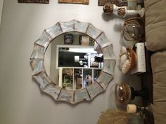 Mirror behind sofa, over sofa table. You could build a simple sofa table since it would mostly be covered up. Family Room Mirror sofa table decor