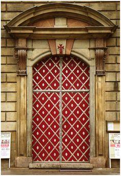 Red, baroque beauty in Prague, The Czech Republic. Doors. Travel.