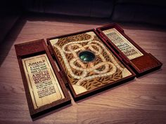 Exact replica of the Jumanji game board. Carved from pine and painted by hand. It comes with game pieces and compartments to store them. The pieces are magnetized, so they will snap to the board just like in the movie. Only 10 will be made, for $305 each. Wish I could afford one.