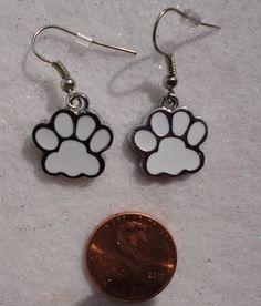 White Dog, Puppy, Cat, Animal Paw Dangle Earrings - Enamel & Silvertone by HappyHillRescue on Etsy https://www.etsy.com/listing/193054981/white-dog-puppy-cat-animal-paw-dangle