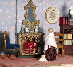A CUPBOARD DOLLHOUSE WITH FURNISHINGS c1870 - c1920 Main Bedroom Level - German chairs c1900 and red-stain bookcase c1920, German metal fireplace attributed to Babette Schweitzer c1910, Art Nouveau mirror, and German woman in silk dress c1880 and dog c1910