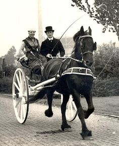 Beautiful vintage photo of a couple driving a sjees.