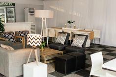 Grey and black furniture setup by GRAND ROOM DESIGN