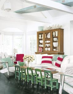 Children's chairs add whimsy and color to this living room.