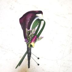 Purple Calla with Dedrobium Orchid bud, lily grass and misty by Seasonal Celebrations.