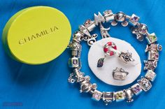 A collection of the exclusive Chamilia charm beads available only in the gifts shops aboard the Disney Cruise Line ships.