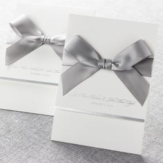 This modern white invitation features embossed frame boarders and a letter-fold jacket that open in the front. || @bwedding