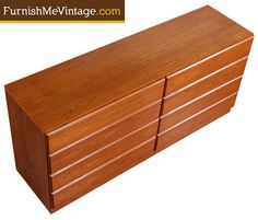 Vintage teak double dresser by American manufacturer, Dixie. This dresser is a rare gem. It is quite uncommon to see an American company use teak in their furniture.