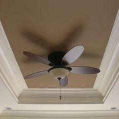 Painted ceilings. Living room, darker than walls with matching ceiling fan