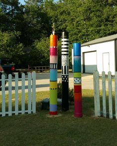 I made these yard totems and framed with cute little sections of picket fence G-mail large PVC pipes -soray paint and handpainted details. Outdoor Art, Outdoor Gardens, Outdoor Decor, Outdoor Ideas, Outdoor Living, Garden Poles, Tower Garden, Pvc Pipe Garden Ideas, Pipe Fence