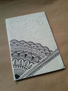 Notebooks handmade in rice paper.The illustrations on the cover are inspired by Indian Mandhi and are  hand-drawn with technique pen.
