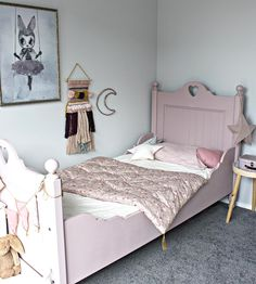 Pink-flowered heaven! Lovely girly bedroom showing Numero74 printed futon, Dusty Pink star lantern, Heart & Star Cushions, mix pink bunting garland.