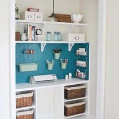 Craft (1/2) Closet // pegboard with baskets and bulletin board on side // floating shelves for fabric, yarn, books // short shelf for larger baskets with current projects