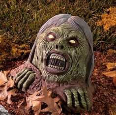 It's alive! Create the look of zombies rising from their graves with this Graveyard Screamer. http://www.planetgoldilocks.com/halloween/decorations.html