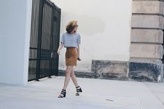 """This week's Chic is wearing the fall """"it"""" skirt."""