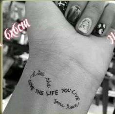 Check out Love the life you live tattoo on wrist. We add new tattoo designs on a daily basis. Some of the coolest tattoos you will ever see. Future Tattoos, New Tattoos, Body Art Tattoos, Cool Tattoos, Tatoos, Awesome Tattoos, Temporary Tattoos, Tasteful Tattoos, Elbow Tattoos