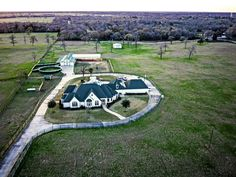 Custom 7353 sf limestone home on 30  AC ranch estate. 5 bd, 4.5 bth, 8 car gar. Home has great rm, dining rm, living rm, media rm, island kitchen, casual dining, office, arcade rm, library/flex rm, mstr suite w fp & sitting rm, 3 terraces, quarters.