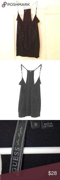 Guess Keyhole Ruffle Racerback Tank Cami Elastic S Guess Black Keyhole Button Ruffle Front Racerback Tank Top. Super cute Cami with Elastic fitting band at waist. Sits just above hips. Size Small. Great condition. Fits true to size. Adjustable straps and you can have Button details buttoned up or closed. So cute!! Guess Tops Blouses