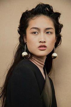 Sphere drop earrings at Marni AW15 MFW. See more here: http://www.dazeddigital.com/fashion/article/23893/1/marni-aw15