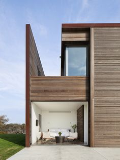 sagaponack house's beautifully finished cedar siding, screens and corten steel siding.