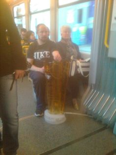 The morning after winning the Swiss Ice Hockey Championships, Mathias Seger, ZSC Lions captain and three-time participant in Olympic Games, is happy to ride Zurich public transportation home with the trophy in his hands. World Of Sports, Zurich, His Hands, Ice Hockey, Olympic Games, Public Transport, Lions, Olympics, Transportation