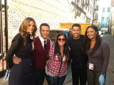 Stana Katic Seamus Dever, Jon Huertas, and Tamala Jones pose with a fan on the set of Castle.