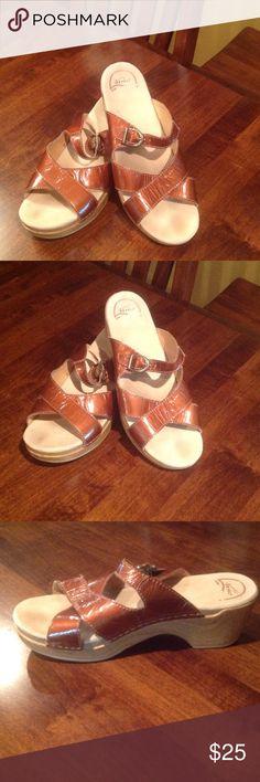 Dansko sandals Side 40. Very comfortable.  2.5 inch heel; 1 inch platform.  Sale will close Thursday 8/4/16 Shoes Sandals