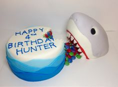 Shark cake.  Carved shark cake eating a birthday cake filled with smarties.