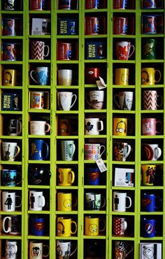 Coffee Mug Wall Cabinet, making a statement with all of your mugs...A nice way to fill a wall as the shelf pictured above.