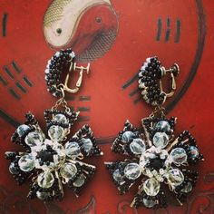 Miriam Haskell lucite sixties flower earrings against an Antique Japanese lacquer box   #MiriamHaskell #flowers #earrings #sixties #vintage #lucite #jewelry #fashion #style #earrings #antique #Japanese #lacquer