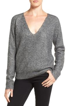 Loving this slouchy rib-textured sweater knit from soft metallic yarn for a luminous sheen. Pair this flattering V-neck style with the favorite denim for a perfectly cozy cool-weather look.