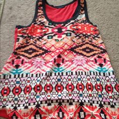 Super cute tank top In great shape. True to size but doesn't stretch much. Chiffon like material Tops Tank Tops