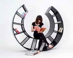 rocking chair book shelf The Motion: Curvaceous Bookshelf and Rocking Chair - world's most lethal rocking chair?