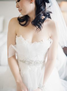 Sheer and sweetheart: http://www.stylemepretty.com/2015/09/07/all-white-wedding-details-we-love/
