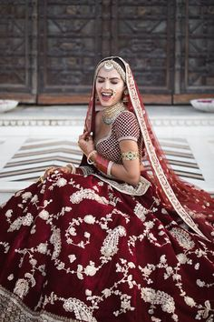 #bride #bridallook #bridaloutfit #redlehenga #bridalpose #bridalphotography #weddingphotography