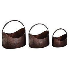 "Three-piece distressed metal planter set with hammered detail.  Product: Small, medium and large planter setConstruction Material: IronColor: BronzeFeatures: Hammered detailingDimensions: Small: 11"" H x 14"" W x 10"" D Medium: 14"" H x 18"" W x 12"" D Large: 18"" H x 21"" W x 14"" D"