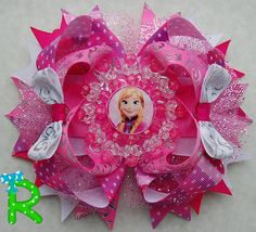 Very cute hair bow for your princess bow collection , this bow is made of grosgrain ribbon with a beaded embellishment . is attached to a French