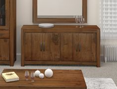 The Kingston Walnut Furniture Collection Walnut Large Low Sideboard   Superb large walnut four door sideboard Constructed using solid walnut Walnut is a very high quality timber with a dense grain, this makes it the perfect choice for building stunning and unique furniture This stylish sideboard provides great storage space within its two large cupuboards internal …