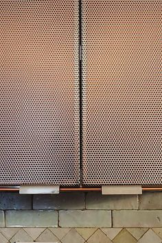 Perforated steel kitchen cabinets