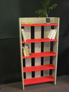 Pallet bookshelf - paint the shelves for a pop of color