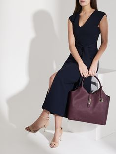 The Key Player Tote knows how to step it up. Complete with a luxe removable microsuede organiser, this versatile and chic handbag easily converts from a spacious semi-structured tote for less formal requirements to a stunning statement work bag with a premium office organiser. Key Player, Working Woman, Workwear, Lion, Dresses For Work, Elegant, Formal, Chic, Leather