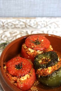 Gemista - stuffed tomatoes with feta cheese and rice. You can also use stuffed peppers in this delicious Greek recipe.