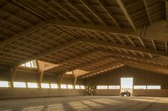 Designed by Portuguese architects Carlos Castanheira and Clara Bastai, this equestrian center uses massive timber structures to house large stables and indoor riding areas. Timber Architecture, Architecture Design, Indoor Arena, Timber Roof, Timber Structure, Horse Barns, Horses, Horse Stables, Modern Barn