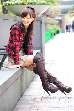 Asian girl in skirt and brown high heel OTK boots
