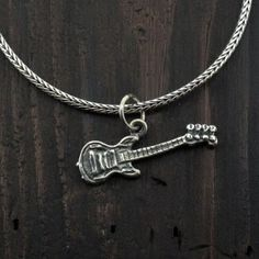 http://purpleleopardboutique.com/566-1256-thickbox/sterling-silver-electric-guitar-charm-pendant.jpg  Sterling silver guitar pendant.