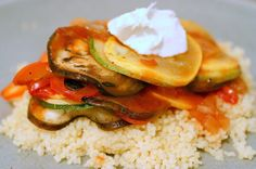 served by smitten, via Flickr  Ratatouille over couscous with a dollop of goat cheese.  Yum!  Maybe try over polenta?