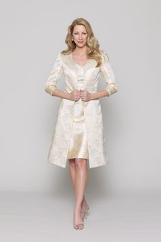 Champagne metallic brocade 2-piece with cap-sleeve, v-neck above the knee length dress with a-line skirt. Collarless, fitted knee-length coat accented with metaillic lace trim and 3/4 length sleeves.