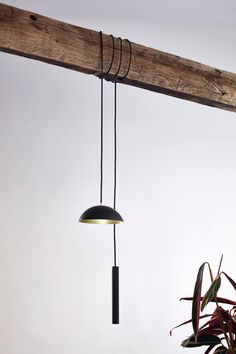 German designer Simon Diener has designed a portable light that is suspended using its wrap-around cord and counterweight.